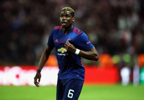 STOCKHOLM, SWEDEN - MAY 24:  Paul Pogba of Manchester United points to the Manchester United badge on his kit following victory in the UEFA Europa League Final between Ajax and Manchester United at Friends Arena on May 24, 2017 in Stockholm, Sweden.  (Photo by Julian Finney/Getty Images)