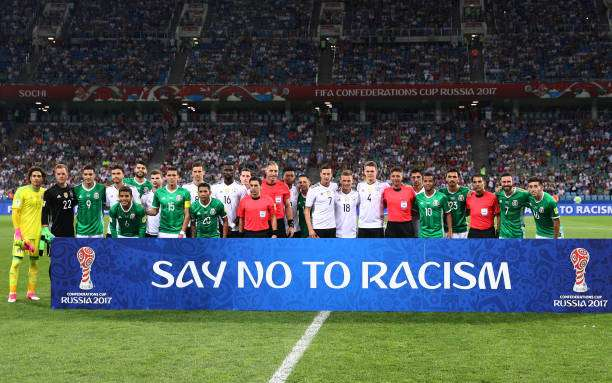 players-and-match-officials-stand-with-an-anti-racism-banner-prior-to-picture-id803447624-800.jpg