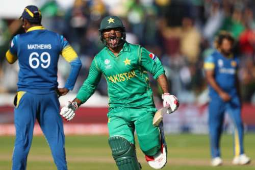 CARDIFF, WALES - JUNE 12:  Sarfraz Ahmed of Pakistan celebrates hitting the winning runs and victory by 3 wickets as Sri Lanka captain Angelo Mathews (L) looks on during the ICC Champions Trophy match between Sri Lanka and Pakistan at the SWALEC Stadium on June 12, 2017 in Cardiff, Wales.  (Photo by Michael Steele/Getty Images)