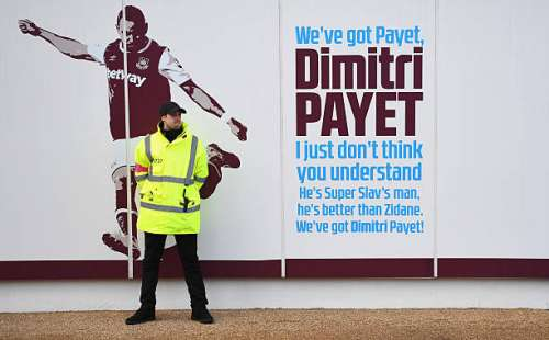 LONDON, ENGLAND - JANUARY 14:  A steward guards the Dimitri Payet of West Ham United sign outside the stadium prior to the Premier League match between West Ham United and Crystal Palace at London Stadium on January 14, 2017 in London, England.  (Photo by Shaun Botterill/Getty Images)