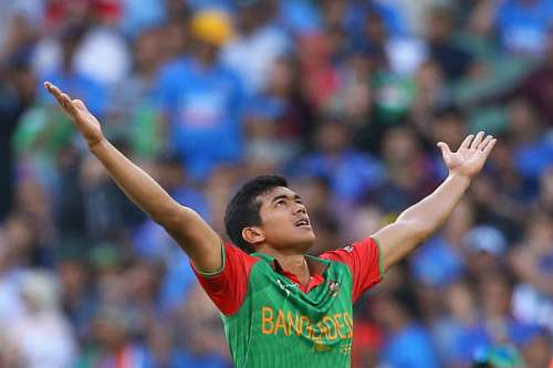 MELBOURNE, AUSTRALIA - MARCH 19:  Taskin Ahmed of Bangladesh celebrates getting the wicket of MS Dhoni of India during the 2015 ICC Cricket World Cup match between India and Bangldesh at Melbourne Cricket Ground on March 19, 2015 in Melbourne, Australia.  (Photo by Quinn Rooney/Getty Images)
