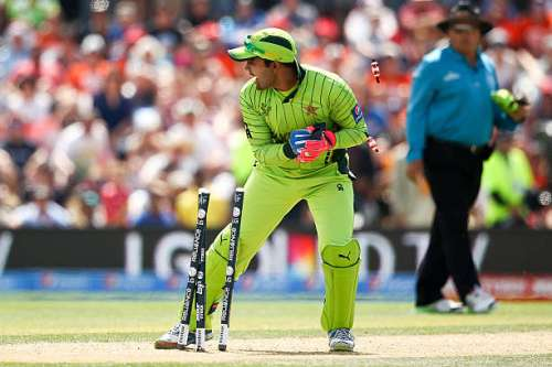 CHRISTCHURCH, NEW ZEALAND - FEBRUARY 21: Umar Akmal of Pakistan runs out Lendl Simmons of West Indies during the 2015 ICC Cricket World Cup match between Pakistan and the West Indies at Hagley Oval on February 21, 2015 in Christchurch, New Zealand.  (Photo by Martin Hunter/Getty Images)