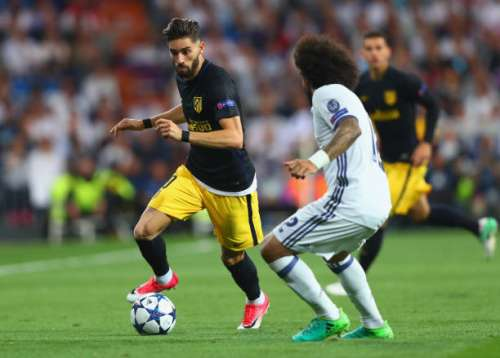 MADRID, SPAIN - MAY 02:  Yannick Ferreira Carrasco of Atletico Madrid is faced by Marcelo of Real Madrid during the UEFA Champions League semi final first leg match between Real Madrid CF and Club Atletico de Madrid at Estadio Santiago Bernabeu on May 2, 2017 in Madrid, Spain.  (Photo by Clive Rose/Getty Images)