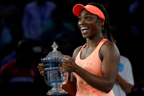 Tennis - US Open - Women's Final - New York, U.S. - September 9, 2017 - Sloane Stephens of the United States reacts with the trophy after defeating Madison Keys of the United States. REUTERS/Andrew Kelly