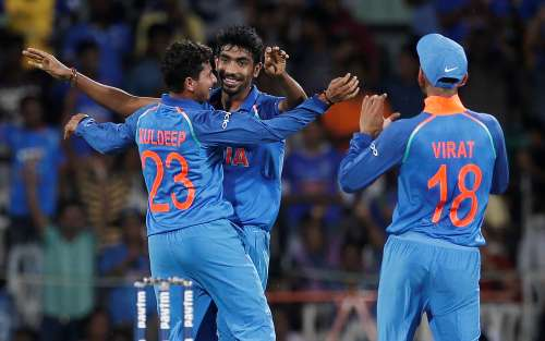 Cricket - India v Australia - First One Day International Match - Chennai, India – September 17, 2017 – Kuldeep Yadav, Jasprit Bumrah and team's captain Virat Kohli (L-R) of India celebrate the dismissal of David Warner of Australia. REUTERS/Adnan Abidi