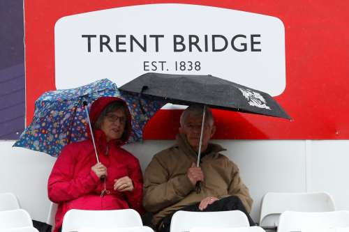 Cricket - England vs West Indies - Second One Day International - Trent Bridge, Nottingham, Britain - September 21, 2017 Fans shelter under their umbrellas as rain stops play Action Images via Reuters/Andrew Boyers