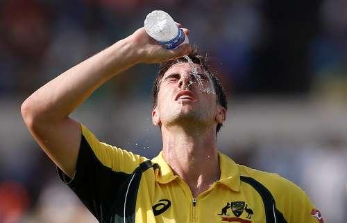 Cricket - India v Australia - Second One Day International Match - Kolkata, India – September 21, 2017 – Australia's Pat Cummins pours water on his face. REUTERS/Adnan Abidi