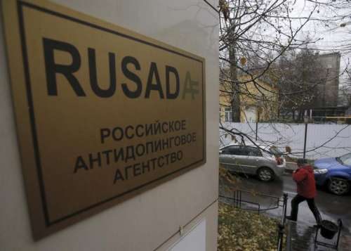FILE PHOTO: A man walks outside an office of the Russian Anti-Doping Agency (RUSADA) in Moscow, Russia, November 10, 2015. REUTERS/Maxim Shemetov/File Photo