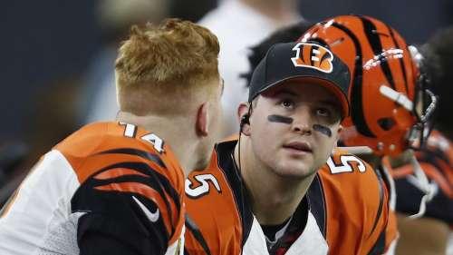 Andy Dalton (left) talks to backup quarterback AJ McCarron