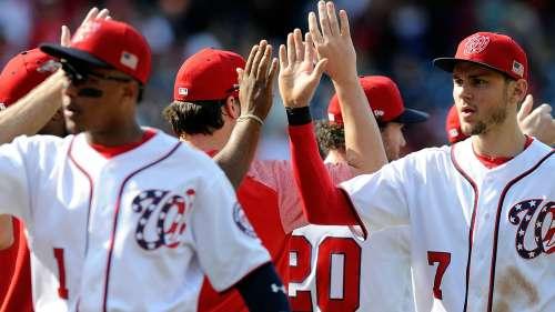 Trea Turner hive-fives Nationals teammates