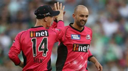 Nathan Lyon celebrates the wicket of Kevin Pietersen with team-mate Jordan Silk